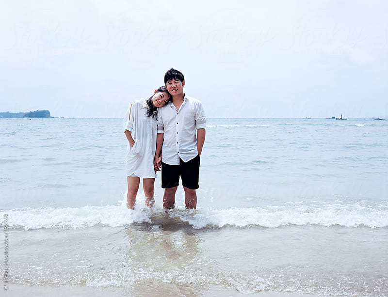 Lovers at the beach by ChaoShu Li for Stocksy United