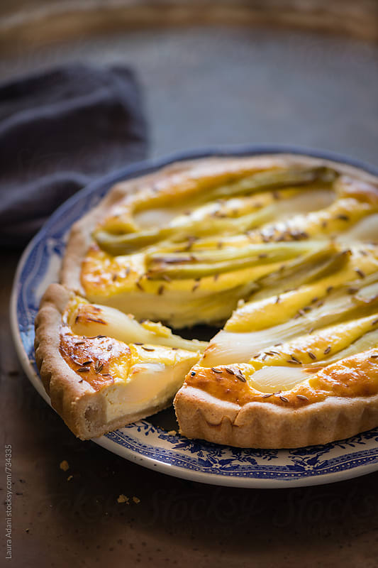 sliced quiche with ricotta and green onions by Laura Adani for Stocksy United