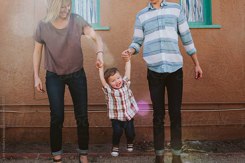 Young Family Playing  by luke + mallory leasure for Stocksy United