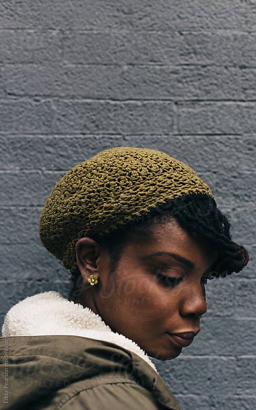 Profile shot of a beautiful african american woman by Eddie Pearson for Stocksy United