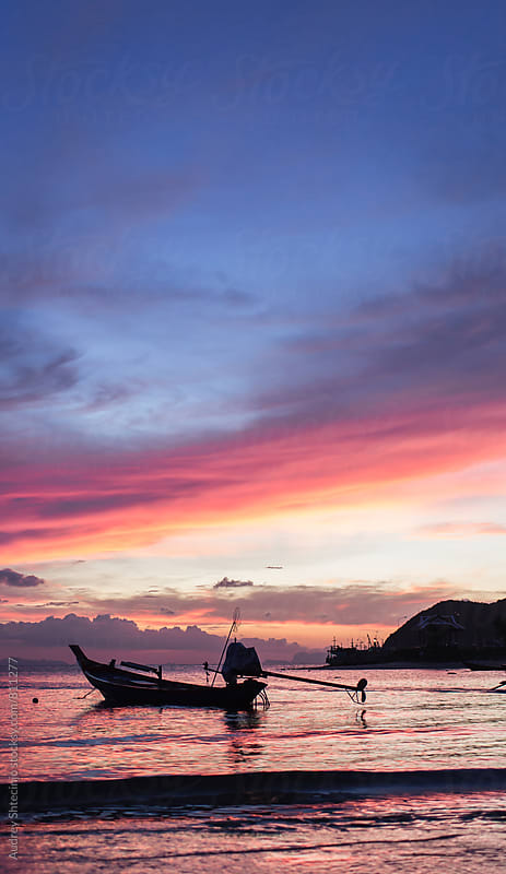 Beautiful sunset with silhouette of fishing boat/Thailand. by Marko Milanovic for Stocksy United