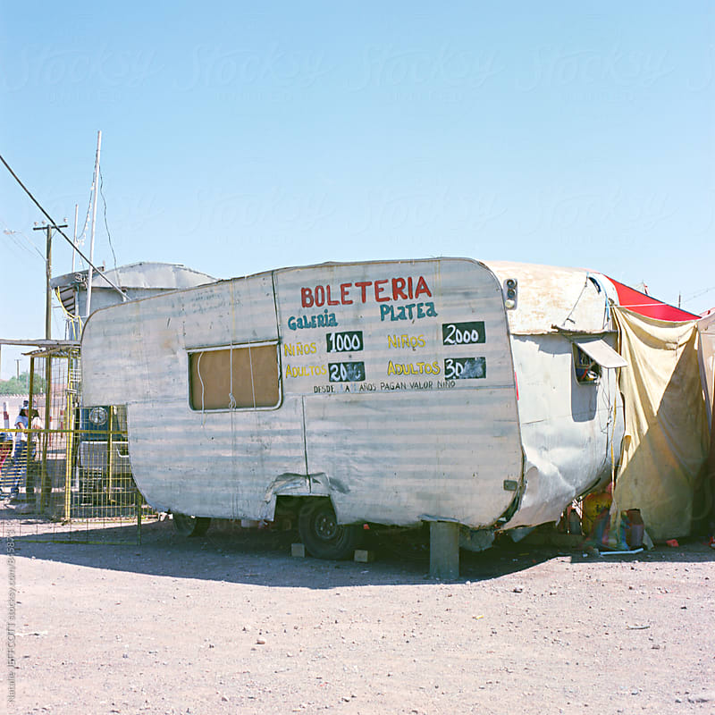 Retro / old caravan selling tickets to a circus in Chile by Natalie JEFFCOTT for Stocksy United