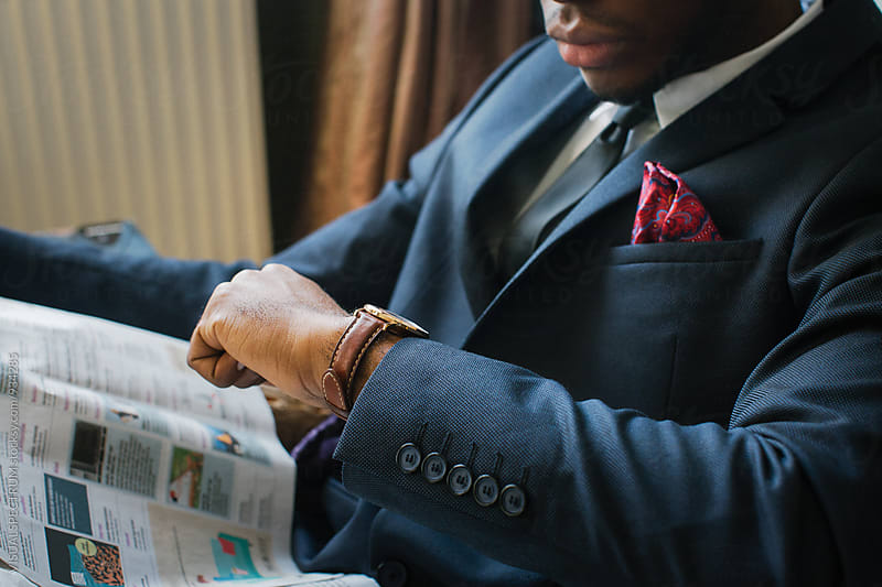 Close Up of Elegantly Dressed Young Black Man Checking Time on Wristwatch by Julien L. Balmer for Stocksy United