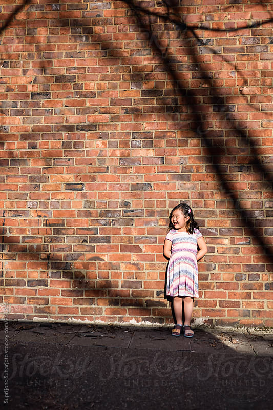 Happy Asian girl outdoor in the city by Suprijono Suharjoto for Stocksy United