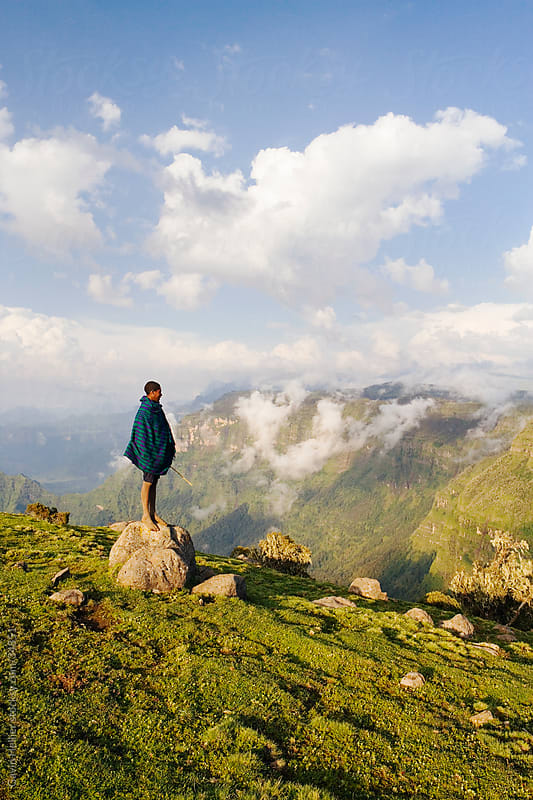Africa, Ethiopia, The Simien Mountains National Park, UNESCO World Heritage Site, view looking towards the Nortern Escarpment near Sankaber, local shepherd boy by Gavin Hellier for Stocksy United
