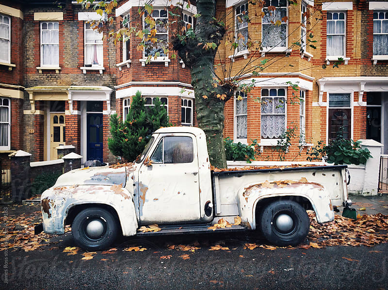 An old truck parked on a suburban street by James Ross for Stocksy United