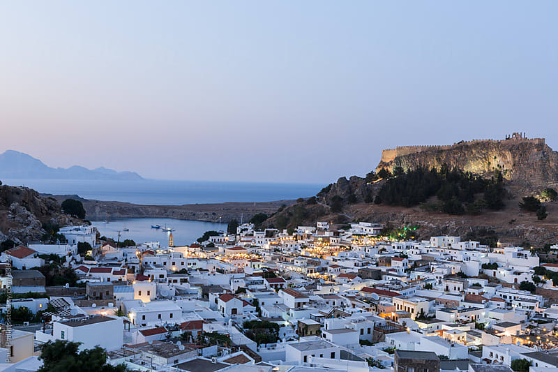 Elevated night view of Lindos and the acropolis on the Greek island of Rhodes by Paul Phillips for Stocksy United