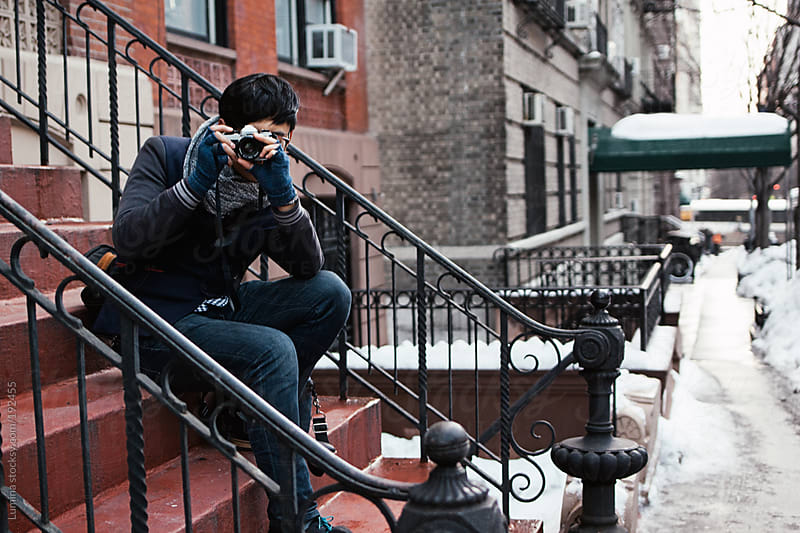 Man Photographing on the Street by Lumina for Stocksy United
