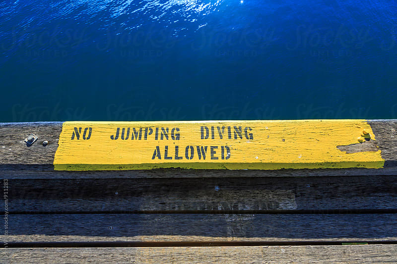 No jumping or diving allowed sign. by John White for Stocksy United