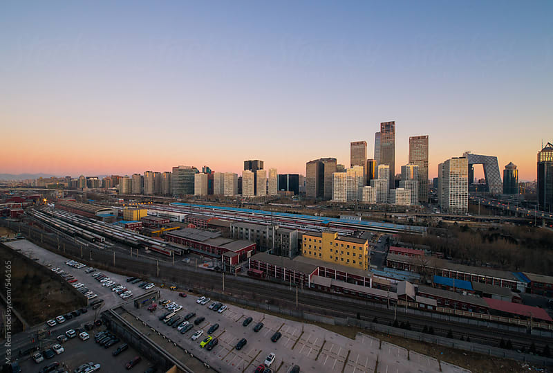The landscape of Beijing at sunrise by Miss Rein for Stocksy United