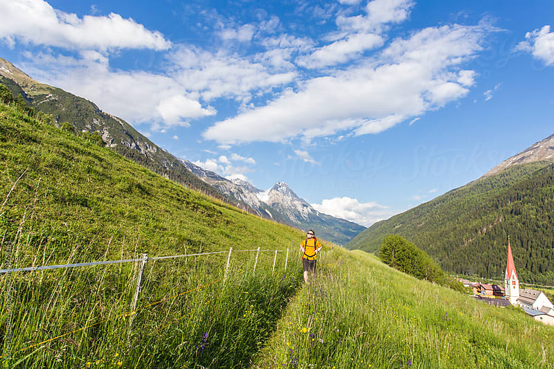Hiking in the mountains of Austria in spring by Soren Egeberg for Stocksy United