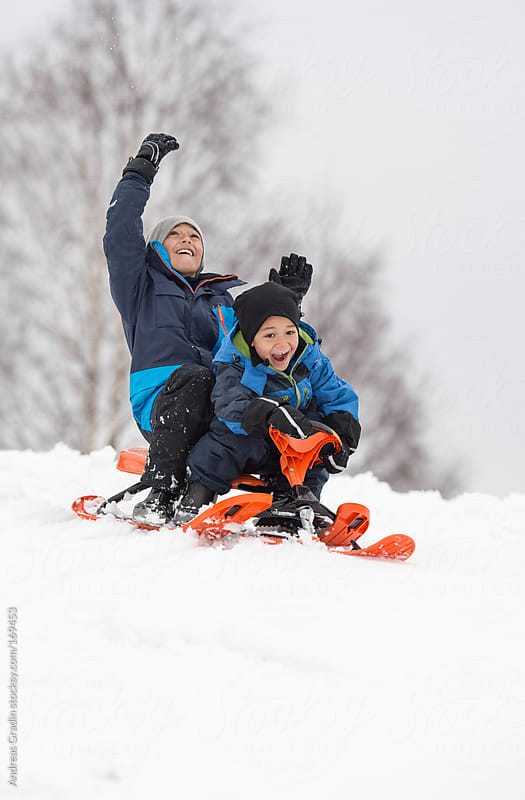 winter sledding fun by Andreas Gradin for Stocksy United
