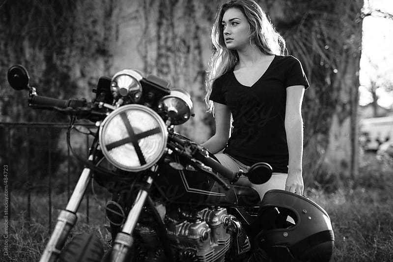 Attractive girl motorcycle rider posing by Dalton Campbell for Stocksy United