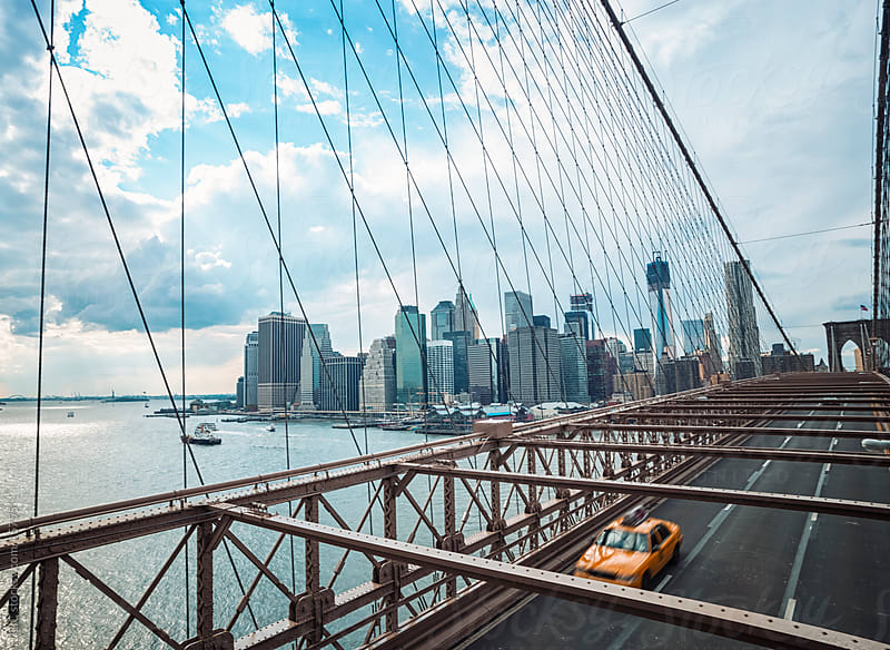 Taxi on Brooklyn Bridge by GIC for Stocksy United