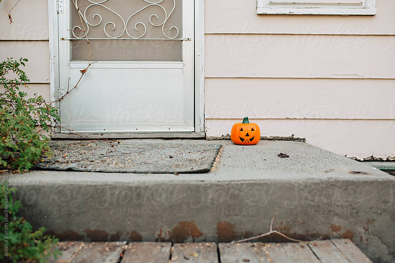 Pumpkin On Porch by Jessica Byrum for Stocksy United
