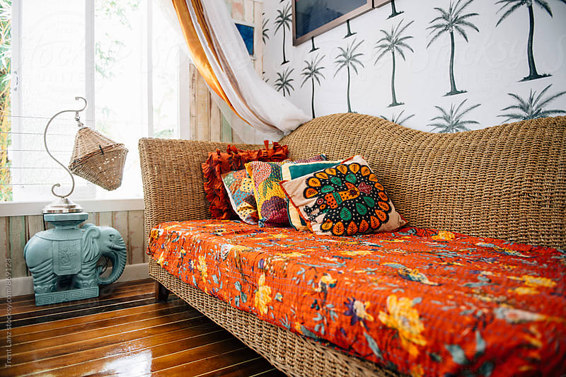Bright wattled sofa with colorful pillows by Trent Lanz for Stocksy United