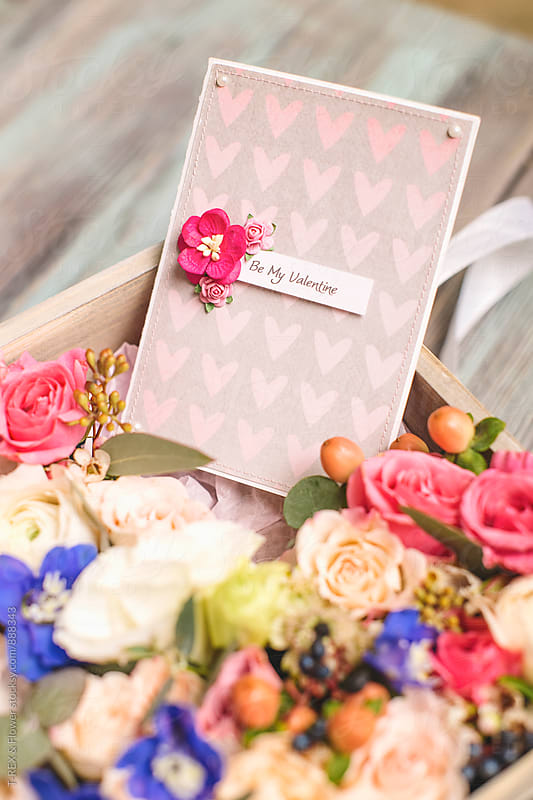 Close-up of beautiful postcard in box with flowers by Danil Nevsky for Stocksy United