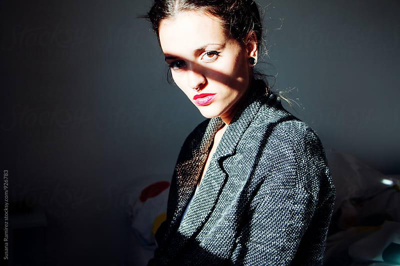 Portrait of a woman in shadows by Susana Ramírez for Stocksy United