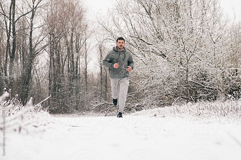 Man running against of winter landscape by Danil Nevsky for Stocksy United