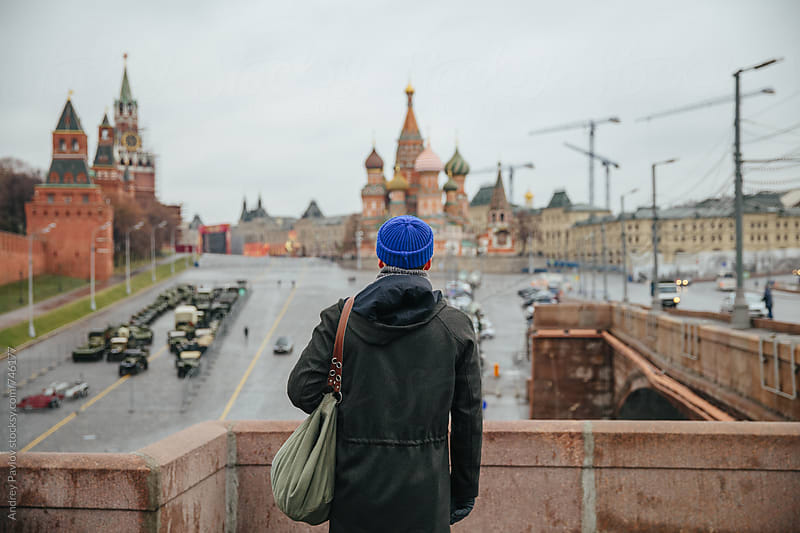 Man looking at Red Square by Andrey Pavlov for Stocksy United