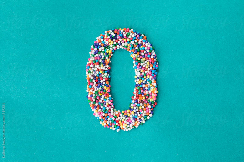The number zero built from nonpareils by Kathryn Swayze for Stocksy United