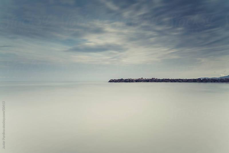 scene of a breakwater at Mediterranean sea by Javier Pardina for Stocksy United