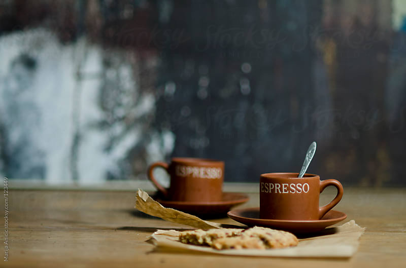 Two cups of fresh coffee with cookies on wooden table by Marija Anicic for Stocksy United