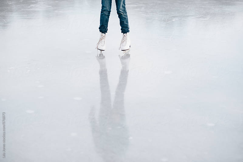 white skates worn by young lady on lake by Léa Jones for Stocksy United