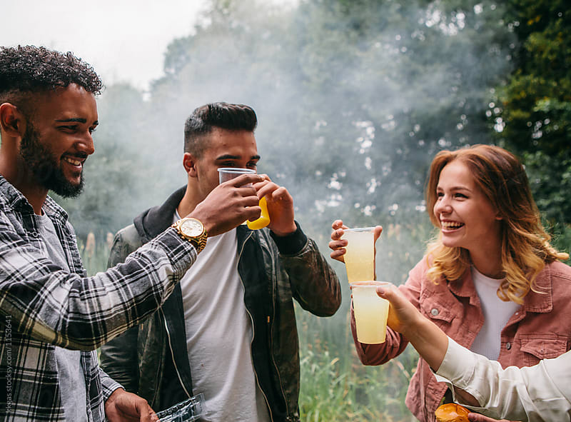 Four friends toasting at a barbecue by kkgas for Stocksy United