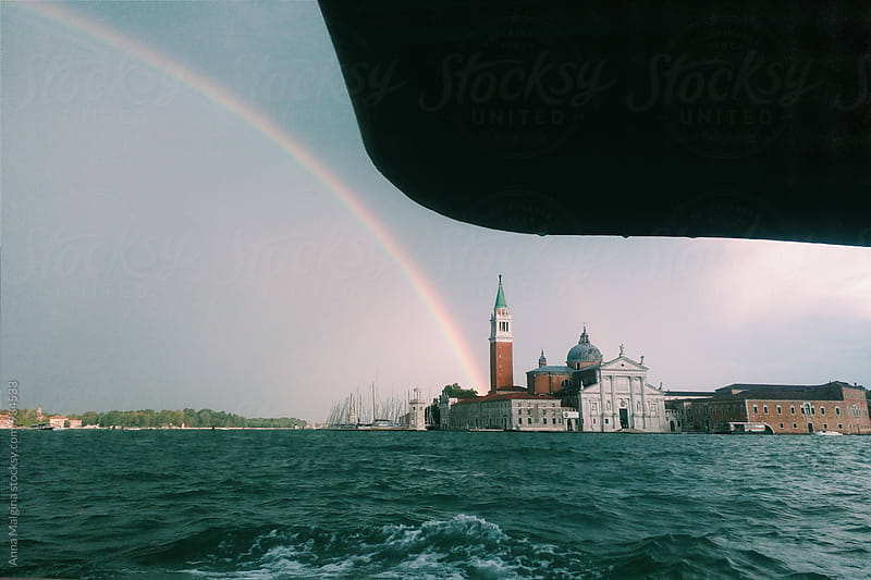 A rainbow on the lagoon of Venice by Anna Malgina for Stocksy United