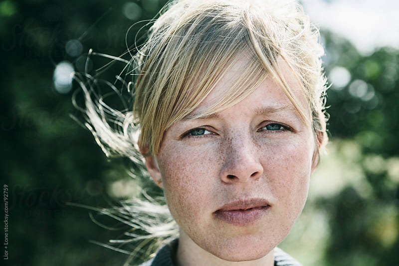 Closeup portrait of a young scandinavian woman by Lior + Lone for Stocksy United