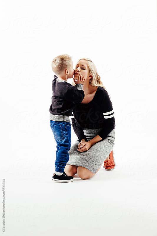 Young boy gives his mother a kiss by Christina Rouse for Stocksy United
