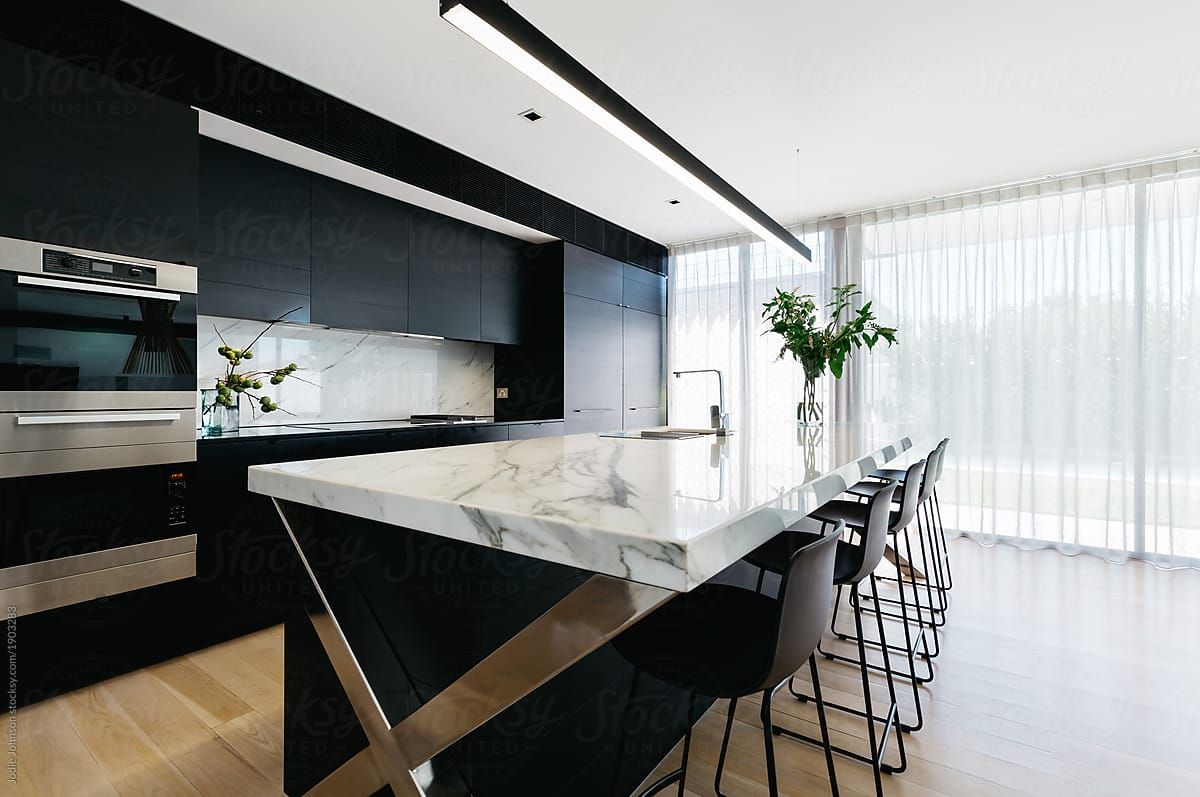 Luxury Open Plan Black Kitchen With Calcutta Marble Benchtop By