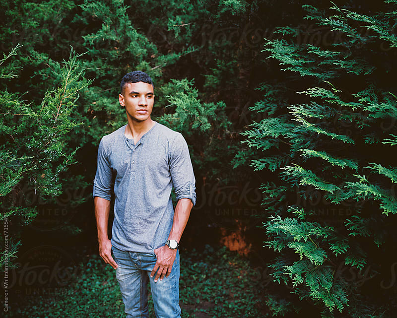 Sunlit nature portraits of a handsome young man by Cameron Whitman for Stocksy United