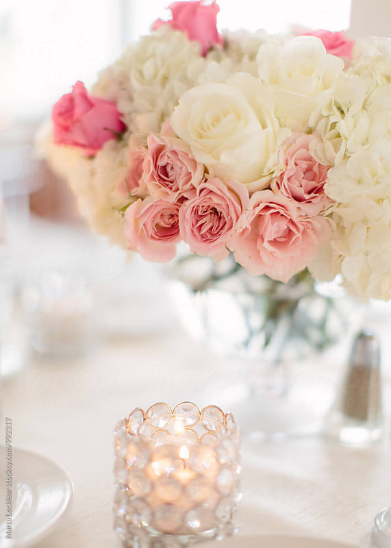 Pink and white flower arrangements by Marta Locklear for Stocksy United