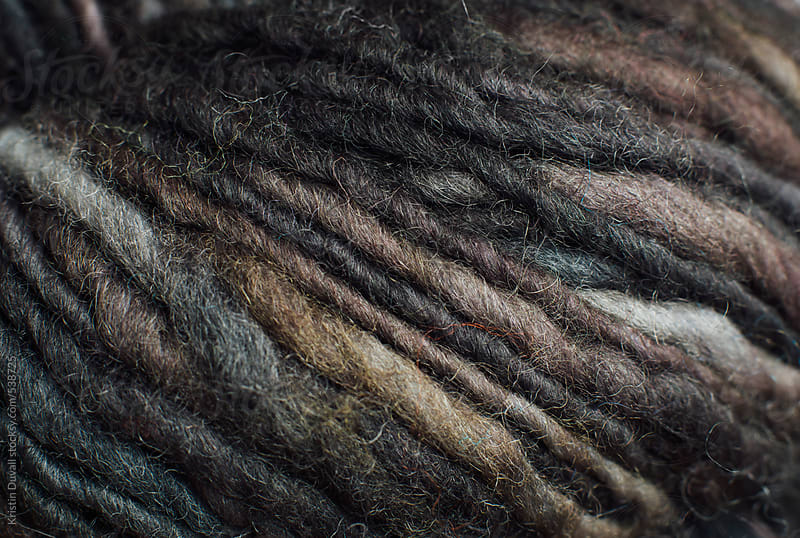 Close up detail of earth tone wool yarn by Kristin Duvall for Stocksy United