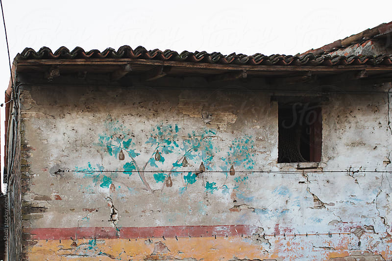 Very ancient wall painting leftovers on old building in Italy by Laura Stolfi for Stocksy United