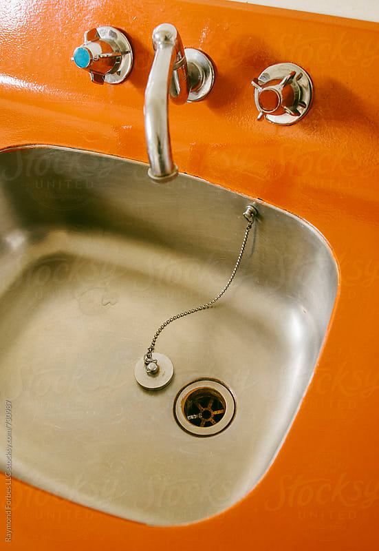 Sink and Faucet en Orange by Raymond Forbes LLC for Stocksy United
