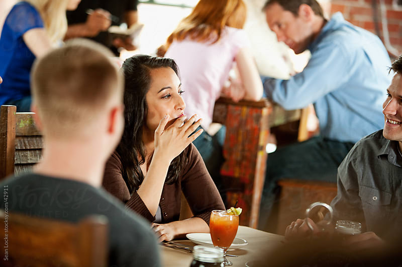 Barbeque: Woman Licks Fingers After Eating Appetizer by Sean Locke for Stocksy United