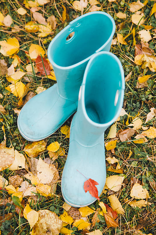 Small blue rubber shoes from above by Danil Nevsky for Stocksy United