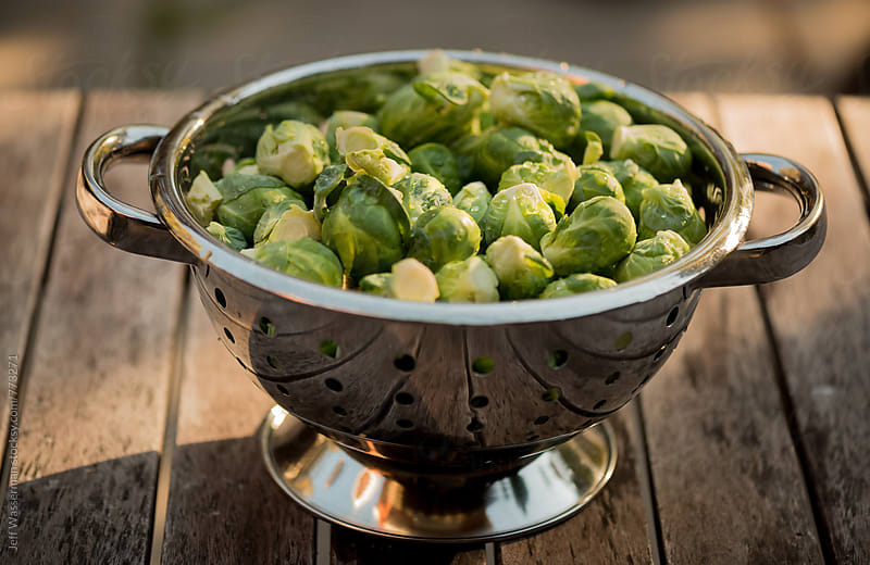 Brussel Sprouts in Colander by Jeff Wasserman for Stocksy United