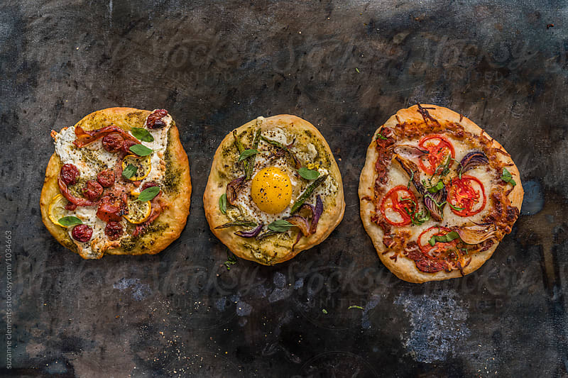 Three Rustic Pizzas by suzanne clements for Stocksy United