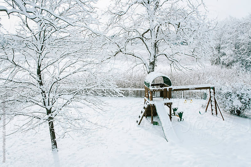 Backyard Playground in Winter. by Raymond Forbes LLC for Stocksy United