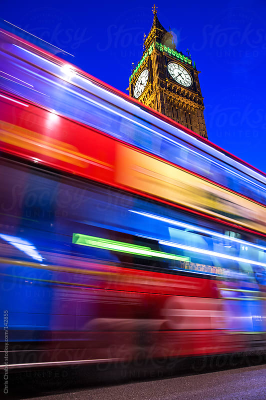 The Night Bus in London passing in front of the Big Ben by Chris Chabot for Stocksy United