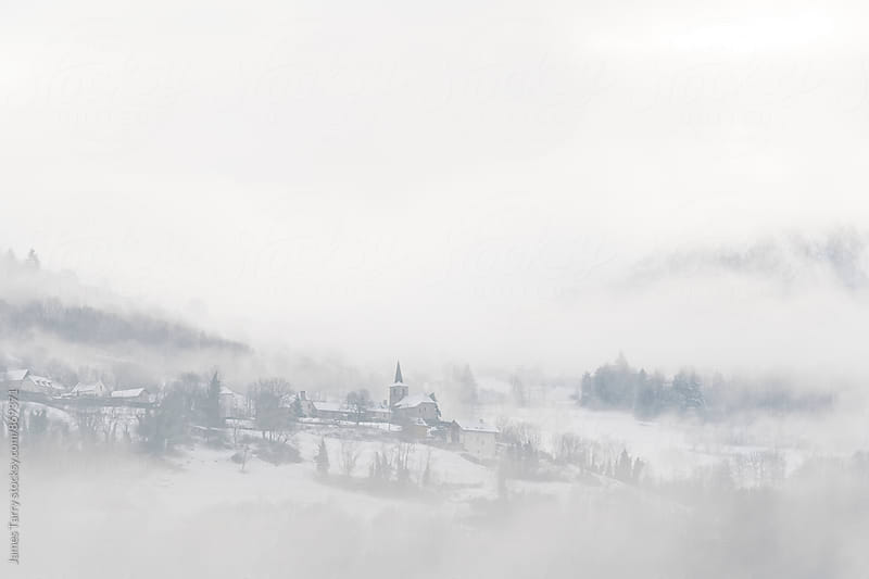 Misty Hilltop village by James Tarry for Stocksy United