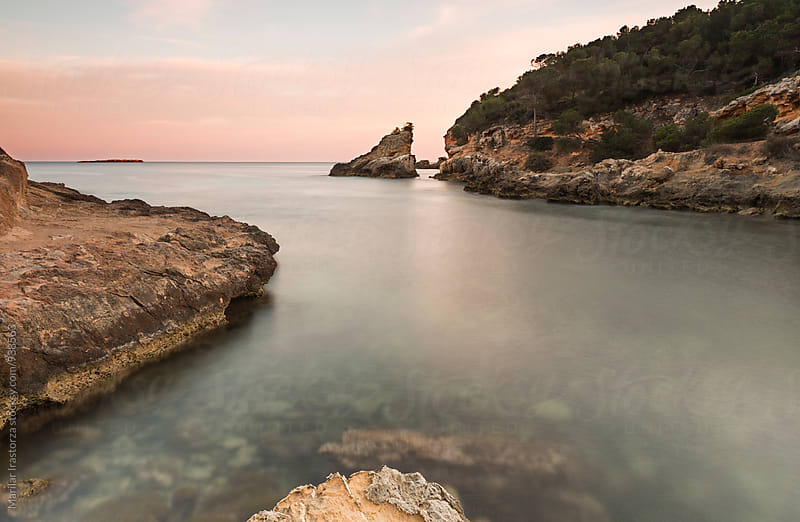 Beautiful cove at sunset in Mallorca by Marilar Irastorza for Stocksy United