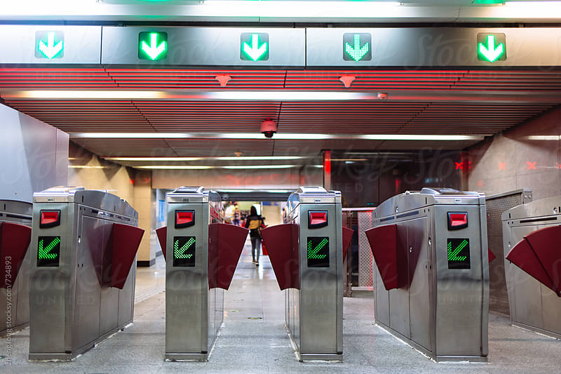 swipe card machine in subway station,Beijing by zheng long for Stocksy United
