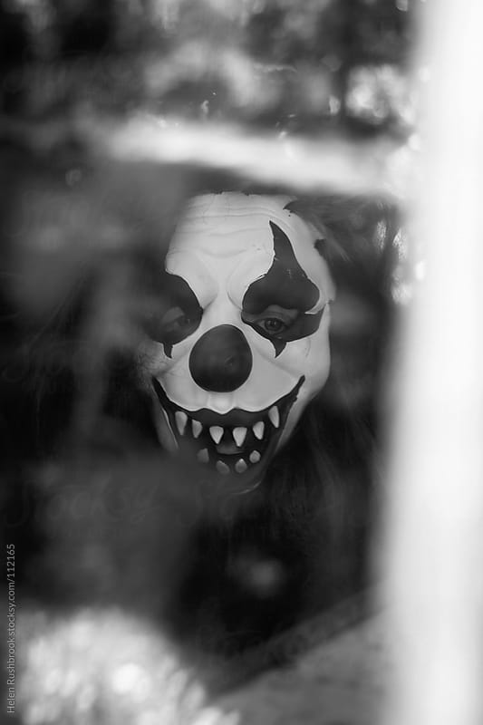 Black and White images of a Creepy clown. by Helen Rushbrook for Stocksy United
