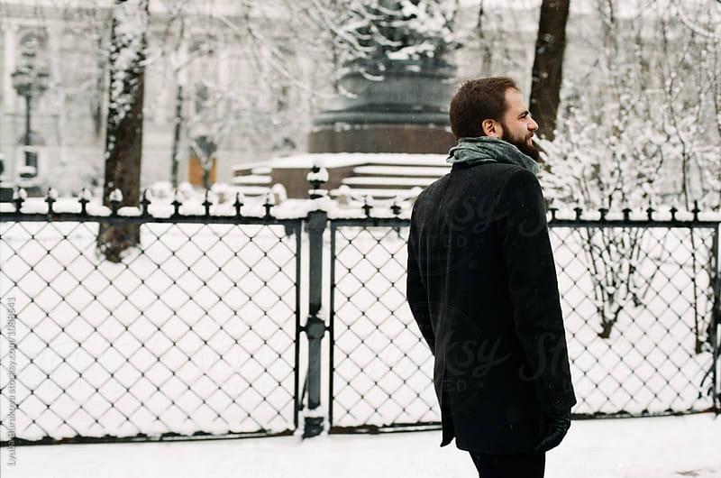 Handsome man walking  by Liubov Burakova for Stocksy United