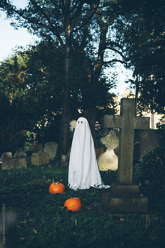 Little boy in halloween ghost costume in a graveyard by kkgas for Stocksy United